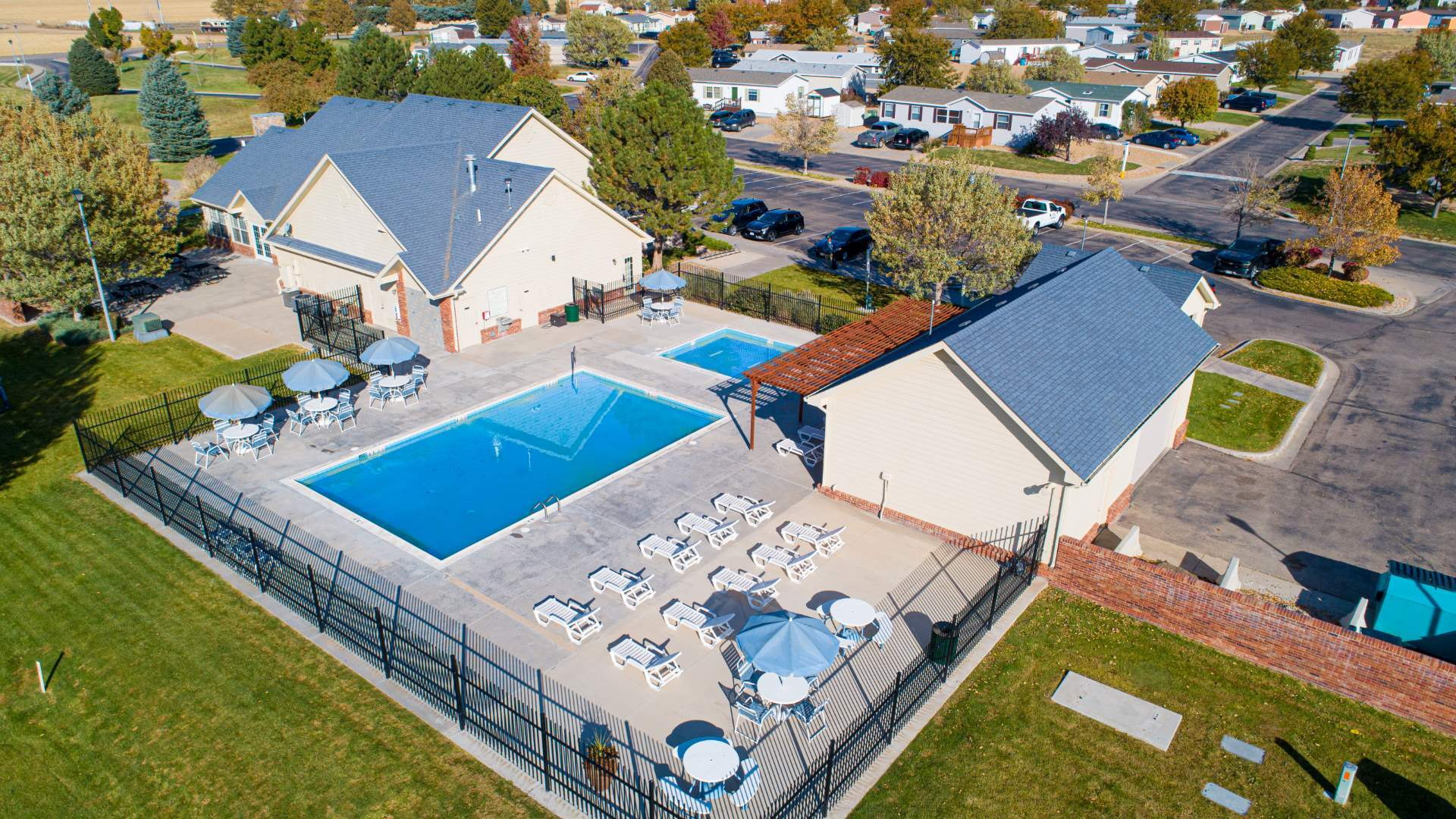 Cave Creek Manufactured Homes Community Aerial Swimming Pool in Evans, CO