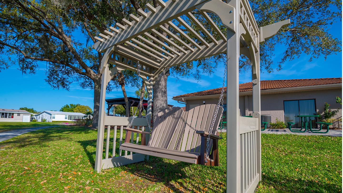 Cypress Greens 55+ Manufactured Homes Community and Golf Course Covered Swing in Lake Alfred, FL