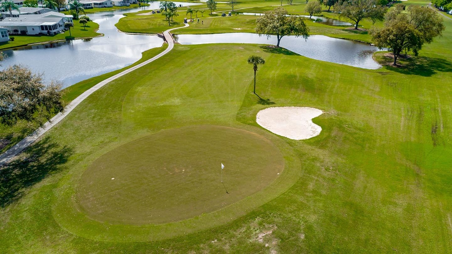 Cypress Greens 55+ Manufactured Homes Community and Golf Course Sand Trap in Lake Alfred, FL