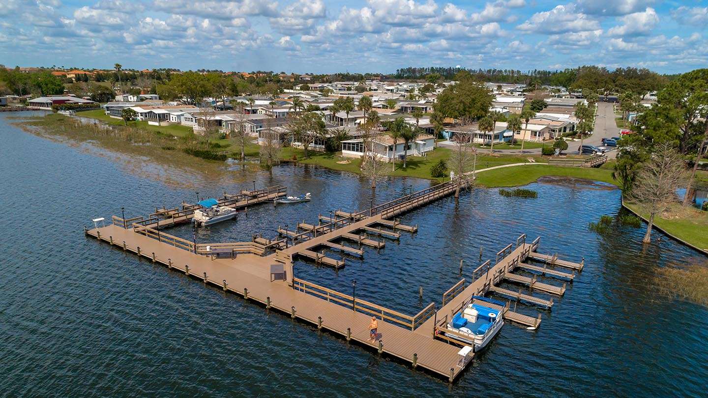 Lake Juliana 55+ Manufactured Homes Community Pier and Boat Slips Aerial View in Auburndale, FL
