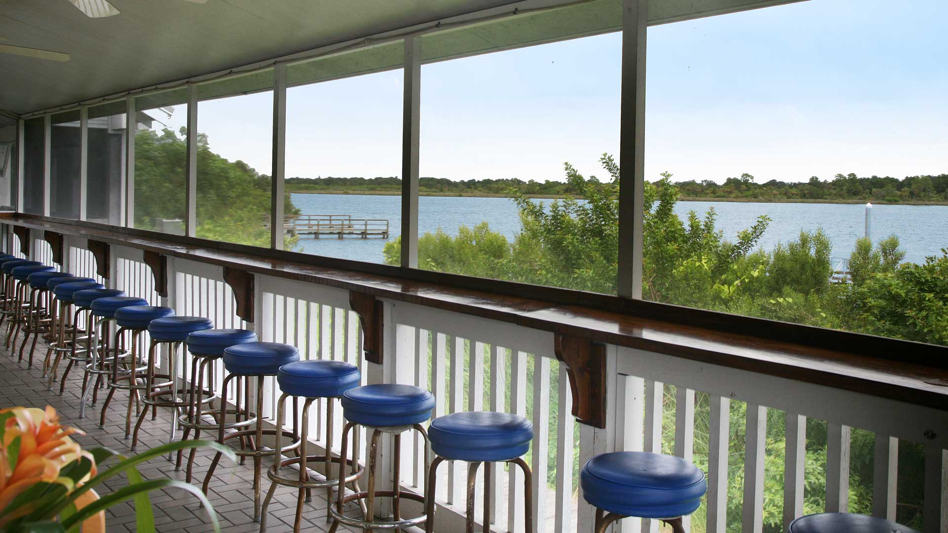 Riverside Club 55+ Golf, Marina and Manufactured Homes Community Bar Stools Looking out to Hayes Bayou in Ruskin, FL