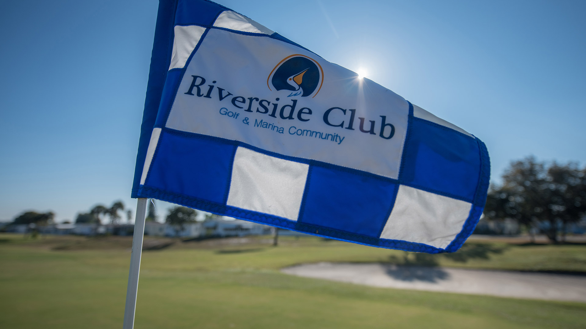 Riverside Club 55+ Golf, Marina and Manufactured Homes Community Blue Checkered Hole Flag in Ruskin, FL