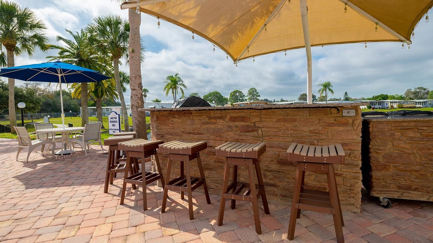 Saralake Estates 55+ Manufactured Homes Community Outdoor Grill Station and Bar in Sarasota, FL
