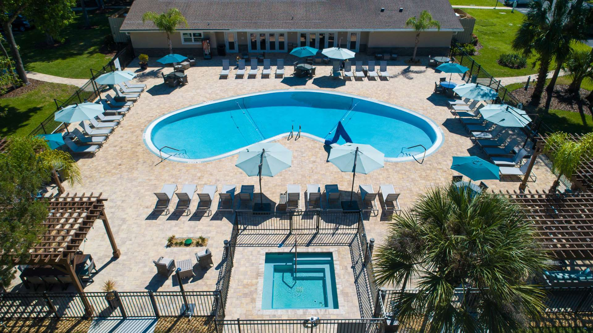 Colony in the Woods 55+ Manufactured Homes Community Aerial Swimming Pool and Hot Tub in Port Orange, FL