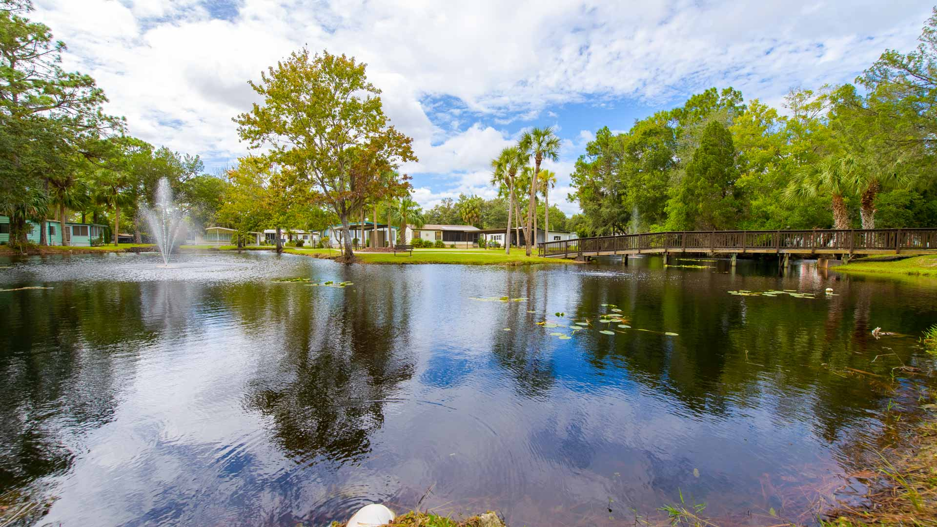 Stonebrook 55+ Manufactured Homes Community Pond Fountain and Foot Bridge in Homosassa, FL