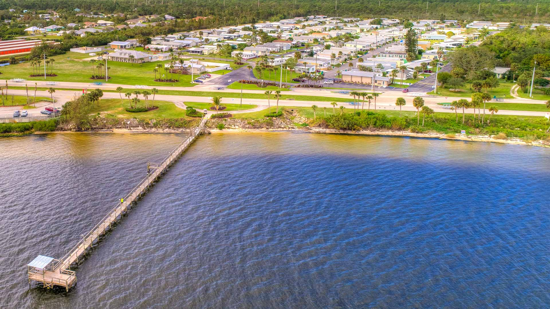Pelican Bay 55+ Manufactured Homes Community Aerial Lagoon and Pier in Micco, FL