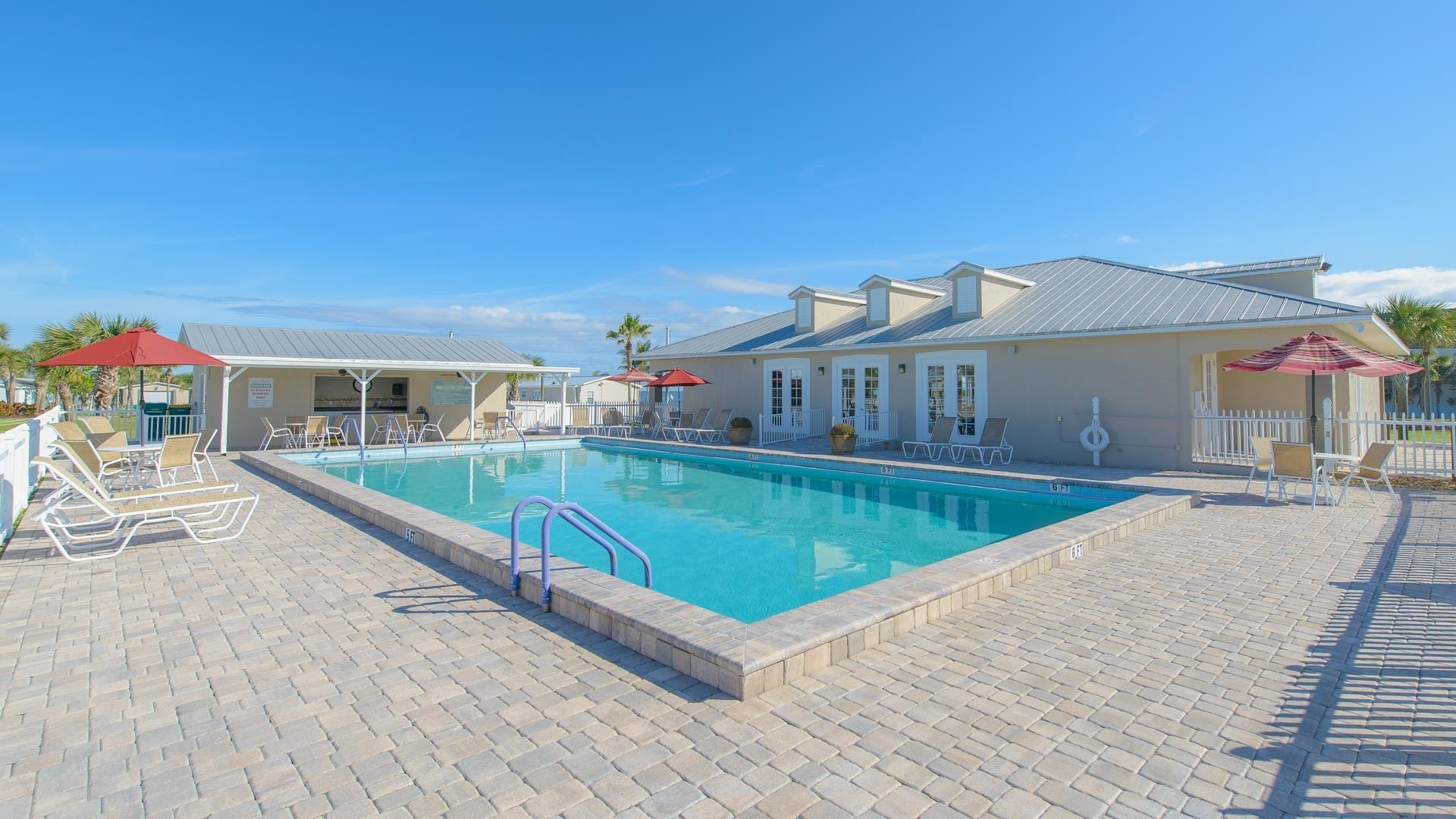 Pelican Bay 55+ Manufactured Homes Community Swimming Pool in Micco, FL